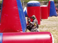 Paintball USA - Player reloading and checking flanks